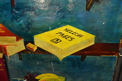 painted depiction of the old yellow pages used for advertisin